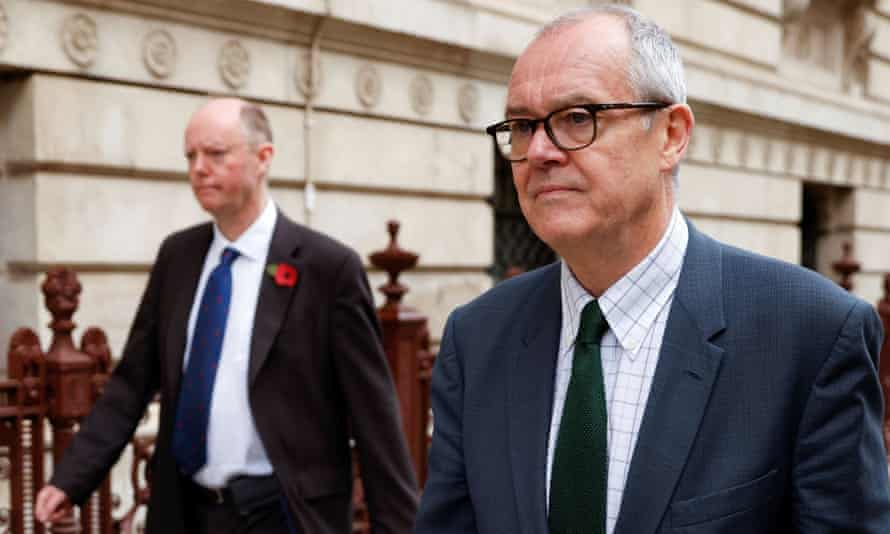 Chris Whitty and Sir Patrick Vallance leave the Foreign Office in London in November.