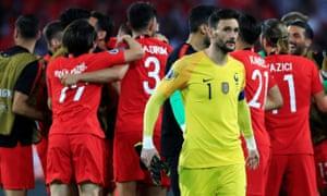 Turkey's players celebrate behind France goalkeeper Hugo Lloris.