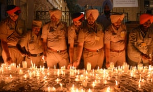 Punjab policemen light candles as they pay tribute to victims of the Amritsar massacre