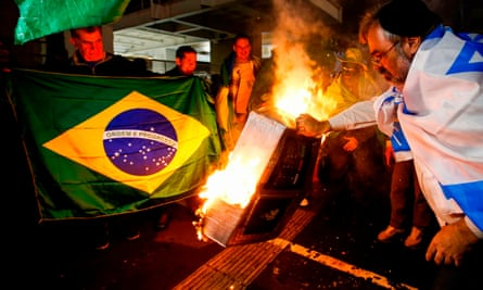 Supporters of Jair Bolsonaro set on fire to a model of an electronic voting device in Sao Paulo, Brazil on Sunday night.