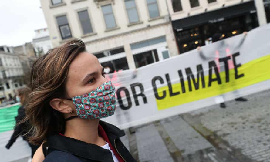 A woman takes part in a climate protest in Brussels