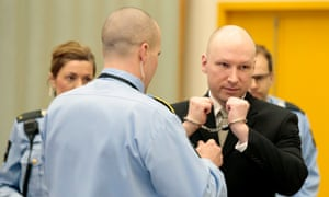 Anders Behring Breivik has his handcuffs removed inside the courtroom at Skien prison