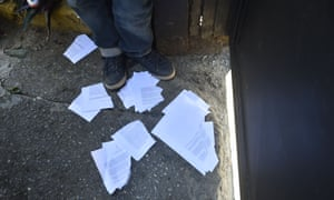 Torn copies of the amnesty measures after being distributed by opposition supporters in Caracas.