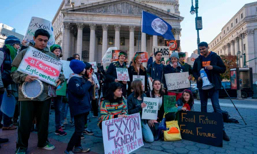 Climate protesters outside the New York county courthouse, where the trial took place. Exxon hailed the ruling in a trial it said stemmed from a 'baseless investigation'.