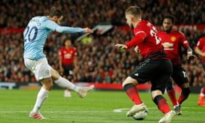 Manchester City's Bernardo Silva fires in their first goal.