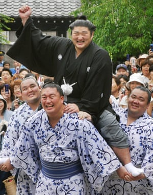 Kotomitsuki Keiji celebrates winning the second-highest rank of Ozeki in July 2007 but in 2010 the Japan Sumo Association announced its decision to dismiss both him and his stablemaster Ōtake for betting on baseball games in a gambling ring run by the yakuza