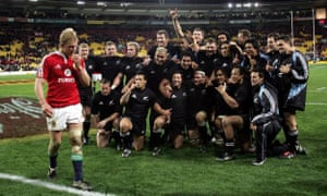 Lewis Moody walks past the jubilant New Zealand players after the All Blacks secured the series at Wellington.
