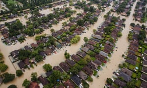 Homes in Houston, Texas, sit in floodwater in the wake of Hurricane Harvey on 29 August 2017