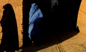 A burqa-clad woman walks in the Afghan city of Herat