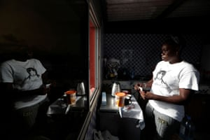 Khadjou prepares breakfast at her coach Rhonda Harris's home, who is the founder of Black Girls Surf (BGS), a training school for girls and women who want to compete in professional surfing