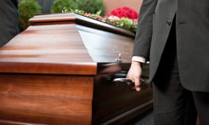 A funeral casket is carried by coffin bearer.
