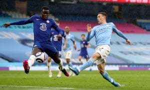 Manchester City's Phil Foden (right) has a shot at goal.