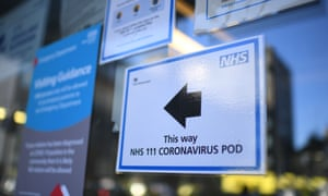 BRITAIN-HEALTH-VIRUS-HOSPITAL<br>A sign points the way to a NHS 111 Coronavirus Pod at The Royal London Hospital in London on March 23, 2020. - Prime Minister Boris Johnson warned on Sunday he may impose tougher controls on the British public as packed parks, markets and cafes at the weekend showed thousands of people defying government warnings about social distancing. The PM gave notice of potential tougher action as the latest health department figures revealed that 281 people had now died from COVID-19 in the UK, an increase of almost 50 fatalities in the past 24 hours, and there are 5,683 confirmed cases. (Photo by DANIEL LEAL-OLIVAS / AFP) (Photo by DANIEL LEAL-OLIVAS/AFP via Getty Images)