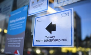 A sign points the way to a NHS 111 Coronavirus Pod at The Royal London Hospital in London