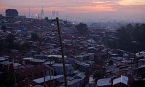 The sun rises over the slum known as Kibera in Nairobi, Kenya