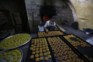 Palestinian baker works to prepare traditional kahk called (Ma'amoul ) inside an old bakery in the old city of Nablus in preparation for the Muslim festival of Eid al-Adha in the West Bank city of Nablus.