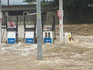 Water floods a gas station.