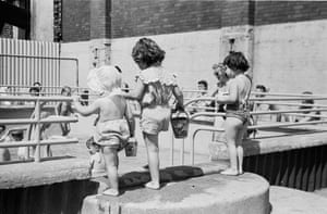 Heatwave, 1952. Children enjoying the sun at a rooftop pool in Holborn, London