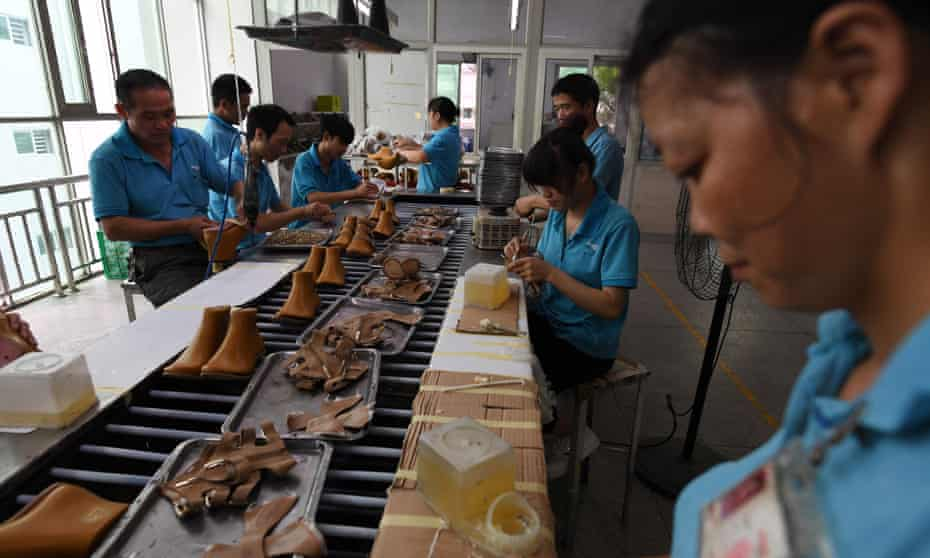 Workers at the Huajian shoe factory, where about 100,000 pairs of Ivanka Trump-branded shoes have been made over the years among other brands.