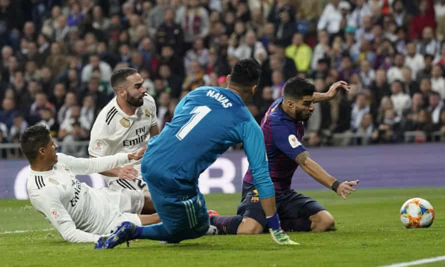 Raphael Varane, far left, scores an own goal in Real Madrid's 3-0 defeat at home to Barcelona.