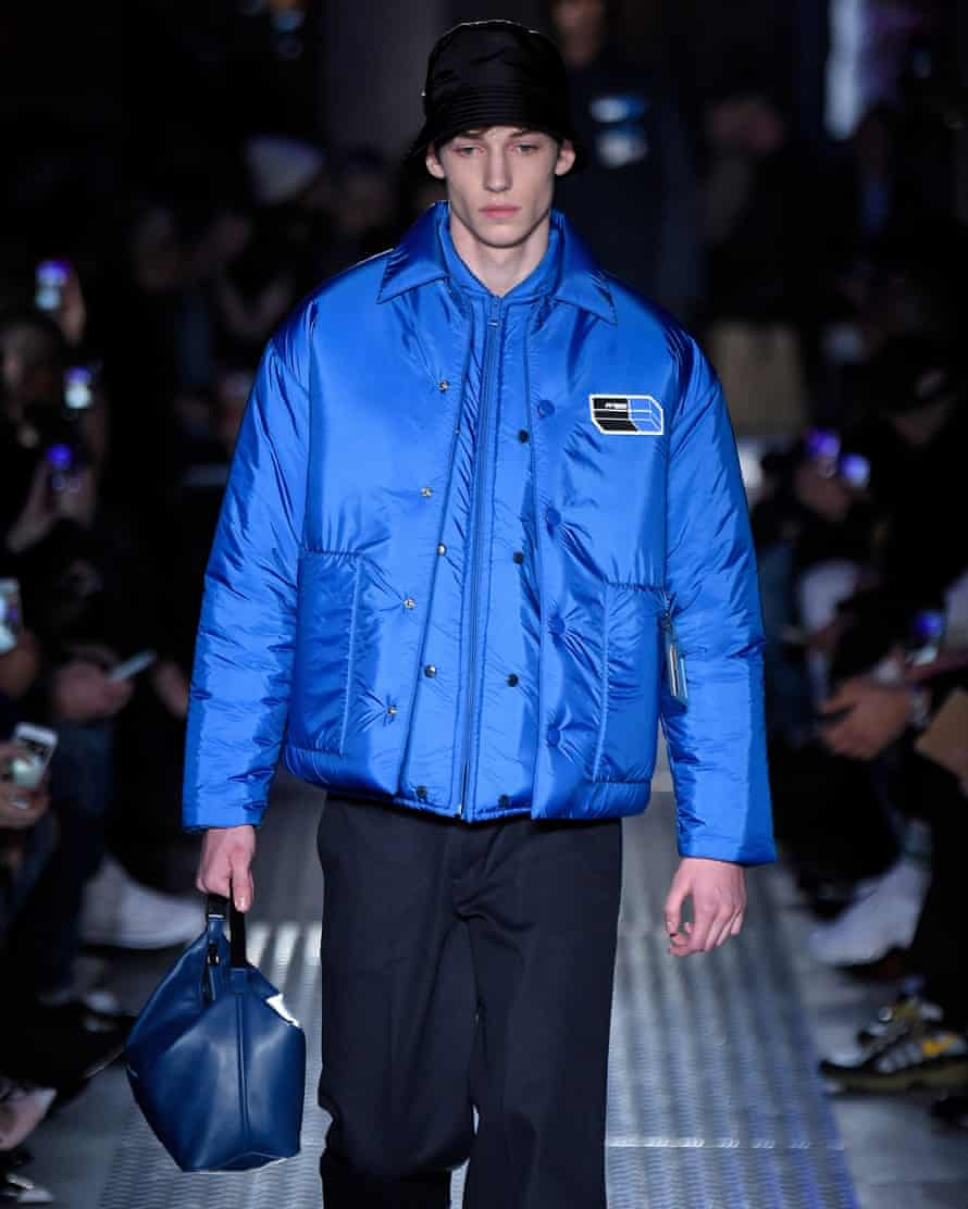 Blue quilted jacket and bag at Prada.