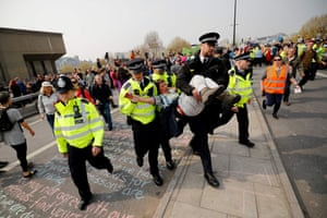 Police arrest a climate change activist on Waterloo Bridge