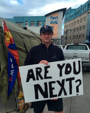"""Fletch, a worker at a Carlton United Breweries depot in Victoria, Australia is protesting against new conditions with a sign reading, """"Are you next?"""""""