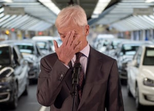 Matthias Müller, CEO of VW, with his hand over his face