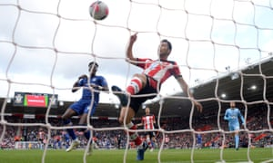 Southampton's Maya Yoshida tries to hook a clearance off the line but Chelsea's opener would be awarded to Tammy Abraham (left).