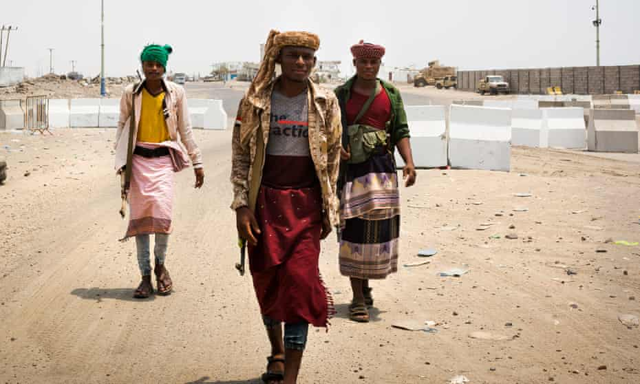 Members of the Southern Transitional Council's forces seen at a checkpoint controlling the entrance to the port city of Aden