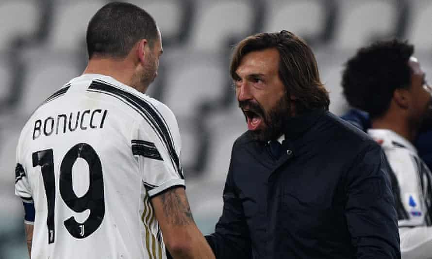 Leonardo Bonucci of Juventus celebrates with head coach Andrea Pirlo