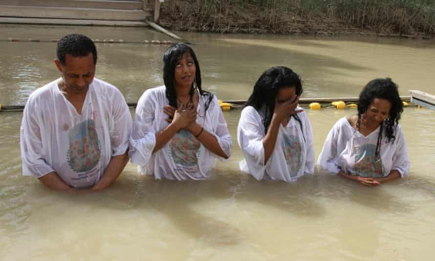 Pilgrims in river