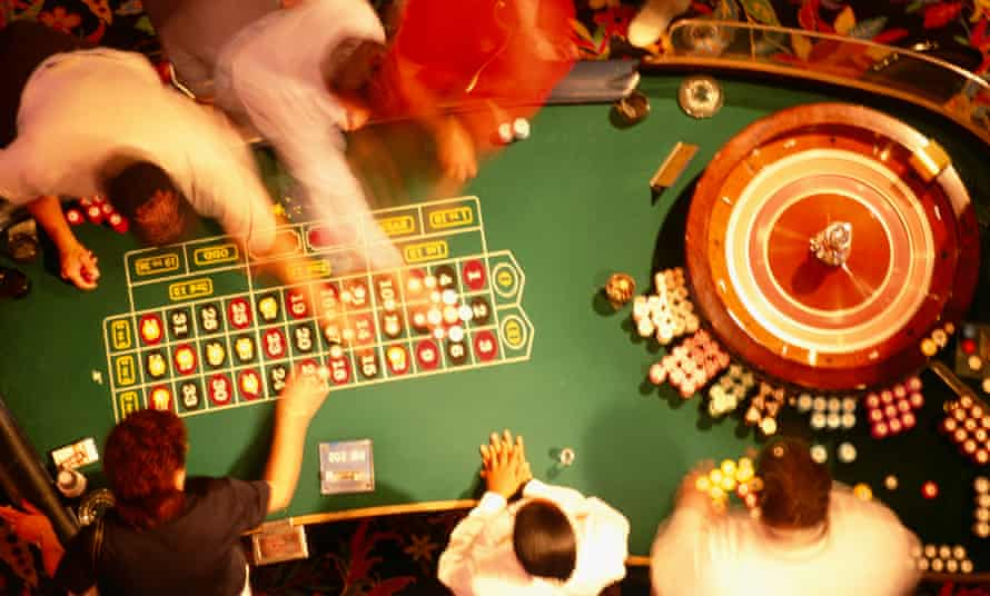 High angle view of a group of people at a roulette table