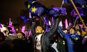 People's Vote supporters celebrate the defeat of Theresa May's deal in Parliament Square.