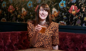 Zoe Williams wearing shoulder pads in a pub in Kings Cross. T-shirt, £265, by Attico, from brownsfashion.com. Makeup and hair: Alexis Day using Tropic and Evo. Photographer's assistant: Beth Davies. Styling: Bemi Shaw