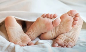 feet of couple in the bed