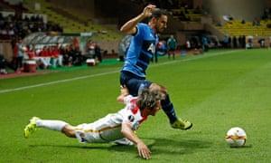 Nacer Chadli takes the ball as Fabio Coentrao falls.