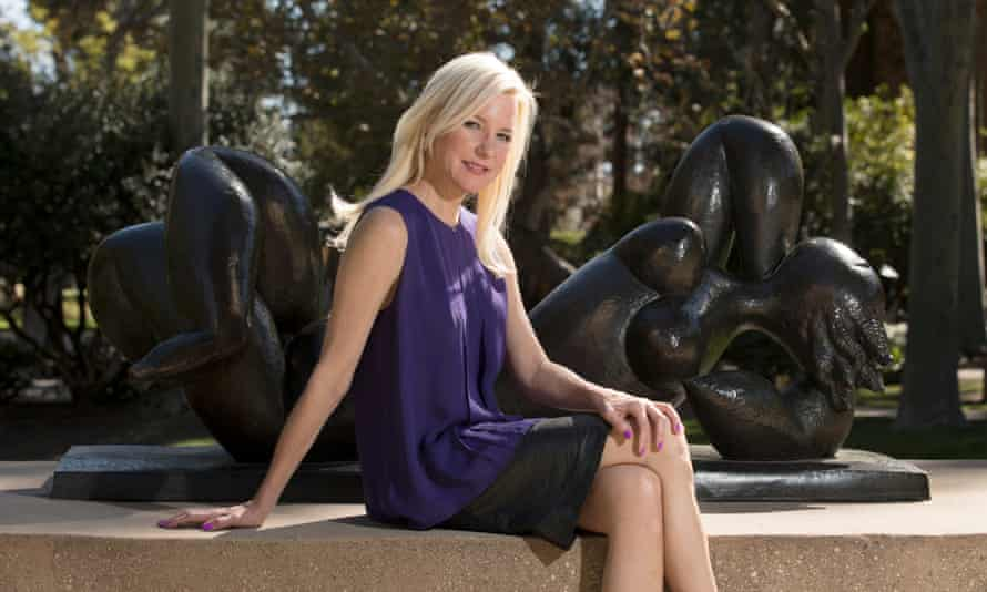 martie haselton posing on the plinth of a statue in the sculpture garden of the university of california los angeles