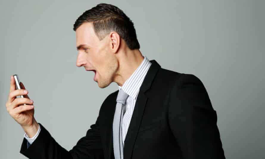 A man shouts into a phone
