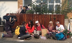 Jeremy Corbyn leaves his house as climate change activists from Extinction Rebellion protest sit after chaining themselves to the front fence of Corbyn's house