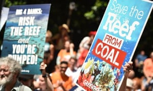 Protesters hold banners outside the Sydney headquarters of the Commonwealth Bank to say no to coal expansion on the Great Barrier Reef as part of global divestment day on 13 February.