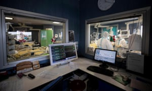 Healthcare workers in PPE at the Cobid-19 emergency ward of the San Filippo Neri hospital in Rome, Italy