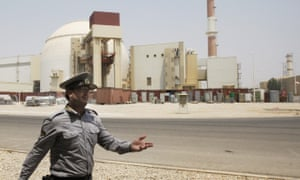 An Iranian security officer at the Bushehr nuclear power plant on 21 August 2010.