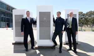 South Australian energy minister Dan van Holst Pelekaan, Neoen Australia managing director Louis de Sambucy and ARENA CFO Ian Kay with the Tesla battery in Adelaide, 19 November 2019