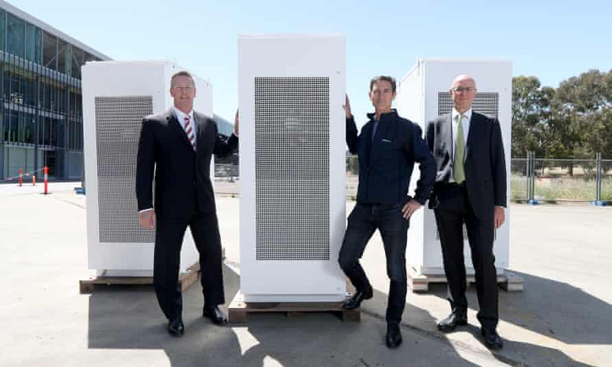 South Australian energy minister Dan van Holst Pelekaan, Neoen Australia managing director Louis de Sambucy and ARENA CFO Ian Kay with the Tesla battery in Adelaide, 19 November 2019