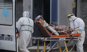 Paramedics take a Covid-19 patient to the Antonio Cardarelli hospital in Naples, Italy, for treatment.