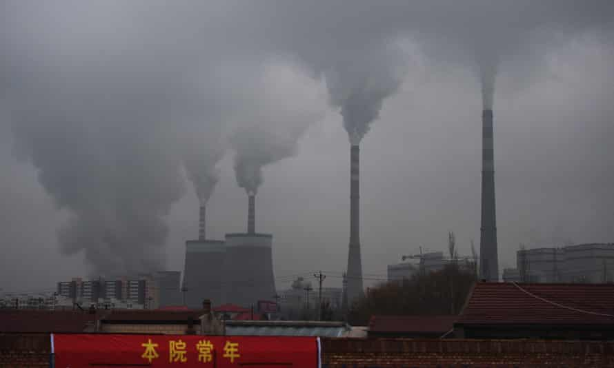 Smoke belches from a coal power station near Datong in China's northern Shanxi province