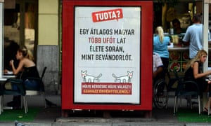 """A poster in Budapest by the Two-Tailed Dog party reads: """"The average Hungarian is more likely to see a UFO than a refugee in his lifetime."""""""