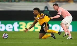 Wolverhampton Wanderers' Adama Traore in action with Sheffield United's John Fleck.
