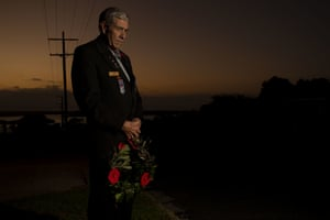 Vietnam veteran RAAF engineer David Milligan stands with a wreath outside his home at dawn in Mallacoota, far east Gippsland.